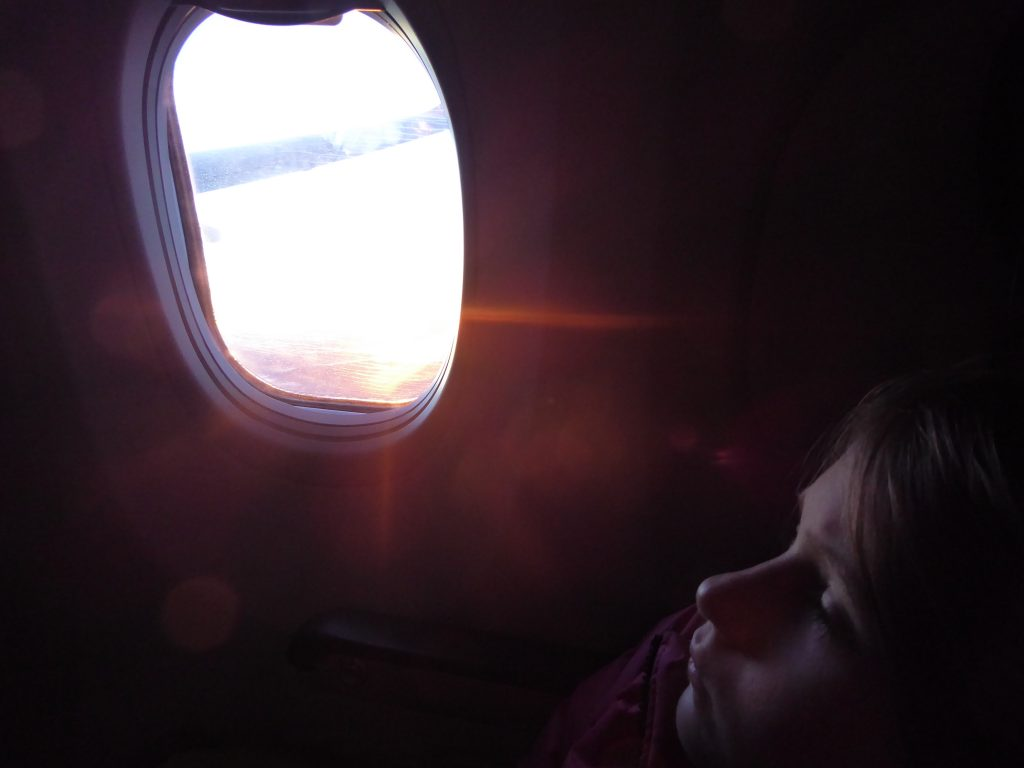 Child resting on a plane