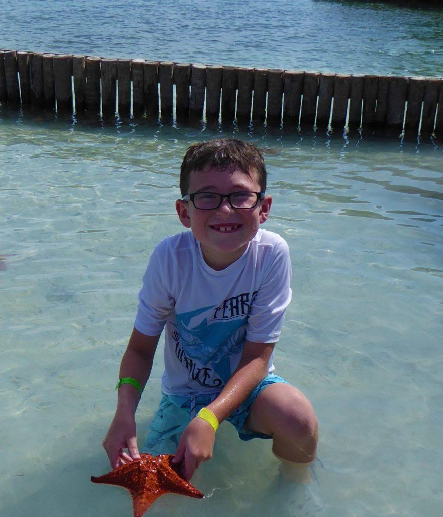 Starfish Island Belize Holding a Starfish
