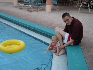 Father and daughter at pool