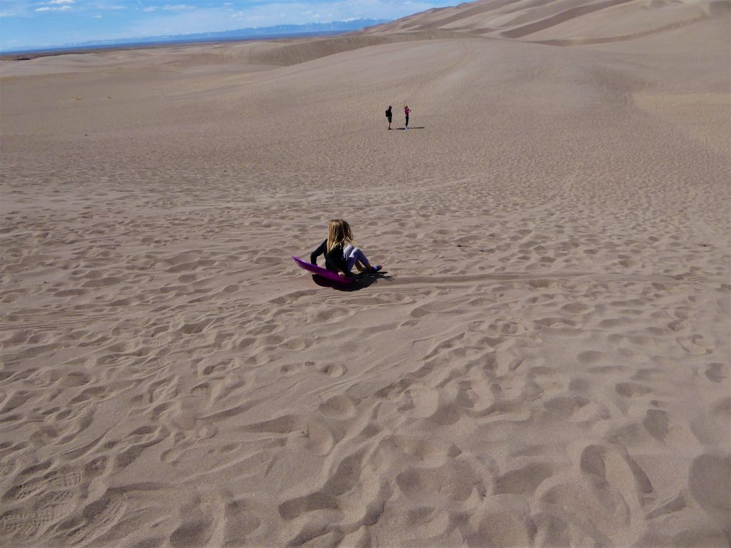 Great Sand Dunes girl sledding